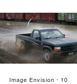 #10 Picture of Young Man Off-roading in a Pickup Truck by Kenny Adams