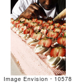 #10578 Picture Of A Man Frosting Cakes