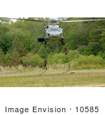 #10585 Picture Of Soldiers Hanging On Ropes Under A Helicopter
