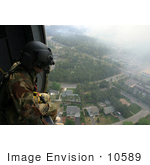 #10589 Picture Of A Soldier Overlooking A City From A Helicopter