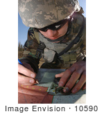 #10590 Picture Of A Soldier Using A Map And Compass