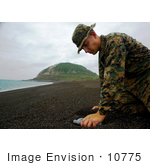 #10775 Picture Of A Soldier Collecting Sand From Iwo Jima