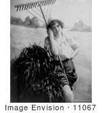 #11067 Picture Of A Woman With A Rake