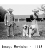 #11118 Picture Of A Couple With Old English Sheepdogs