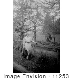 #11253 Picture Of Helen Keller By A Fence