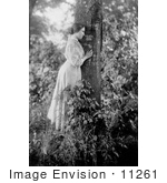 #11261 Picture Of Helen Keller Resting Against A Tree
