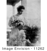 #11262 Picture Of Helen Keller Watering A Plant
