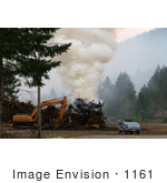 #1161 Picture Of A Controlled Fire Beside A Tractor And Truck