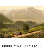 #11802 Picture Of Dirt Road And Houses By Mountains Switzerland