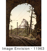 #11963 Picture Of Train Tracks In A Tunnel And Matterhorn Mountain