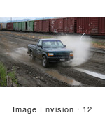 #12 Picture Of An Off-Road Enthusiast Driving Through Muddy Terrain