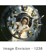 #1238 Photo of a Riveter Woman Framed by a Circular Opening of a Cowling, Working on Lower Section by JVPD