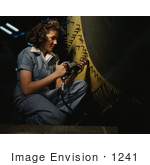 #1241 Stock Photo Of A Riveter Woman Working On A Consolidated Bomber