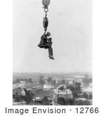 #12766 Picture of a Photographer and Camera Suspended Above a Town by JVPD
