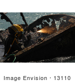 #13110 Picture Of A Navy Diver Cutting Parts Of A Shipwreck
