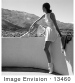 #13460 Picture of a Young Caucasian Woman in a Tennis Uniform, Sitting on a Balcony by JVPD