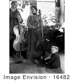 #16482 Picture Of A Family Of 3 With Parents Posed With Cellos And Son On The Floor