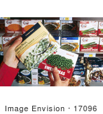 #17096 Picture Of A Woman'S Hands Holding Two Boxes Of Frozen Peas Trying To Decide Whether Or Not To Make A Healthy Decision