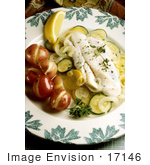 #17146 Picture Of A Fish Meal Served With Boiled Potatoes Steamed Zucchini And Squash And A Spring Of Parsley With A Lemon Slice