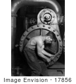 #17856 Photo of a Strong Mechanic Man Using a Wrench While Working on a Steam Pump by JVPD