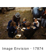 #17874 Photo Of A Family Sitting On Grass While Eating At A Fair In Pie Town New