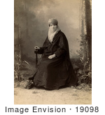 #19098 Photo Of A Turkish Woman Wearing A Niqab Veil On Her Face Sitting In A Chair Holding A Parasol