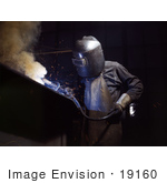 #19160 Photo of a Welder in Protective Clothing, Bending Over While Making Boilers by JVPD