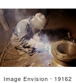 #19162 Photo Of A Welder Crouching While Making Boilers For A Ship