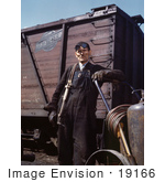 #19166 Photo Of A Male Welder Standing By A Railroad Car