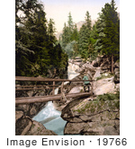 #19766 Photo Of A Man Standing On A Footbridge Above The Upper Waterfall Of The Great Kohlbach In The Tatra Mountains