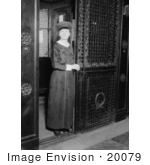 #20079 Stock Photography: Female Elevator Attendant Holding a Door Open at the Martha Washington Hotel by JVPD