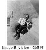 #20516 Historic Stock Photography of an Exhausted African American Boy With a Shoe Shine Box, Taking a Break From Shoeshining by JVPD