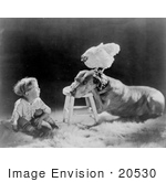 #20530 Stock Photography of a Little Boy Sitting by a Dog With a Chicken on His Head, 1920 by JVPD