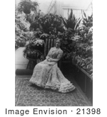#21398 Stock Photography Of First Lady Ida Saxton Mckinley In A Gown Holding A Hand Fan In Her Lap Sitting In A Garden