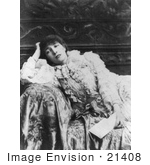#21408 Stock Photography of the Actress Sarah Bernhardt Holding a Letter and Leaning Against the Arm of a Sofa by JVPD