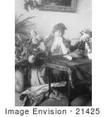 #21425 Stock Photography Of The Actress Sarah Bernhardt Holding A Hanky Sitting Behind A Table