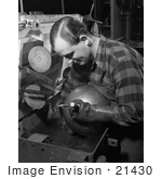 #21430 Historical Stock Photography Of A Male Worker Inspecting An Aviation Oxygen Cylinder At A Factory 1942