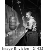 #21432 Historical Stock Photography Of A Male Worker Sterilizing Beverage Containers 1942