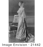 #21442 Stock Photography Of Alice Roosevelt Longworth In A Gown Standing By A Chair And Holding A Folded Hand Fan
