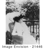#21446 Stock Photography Of Alice Roosevelt Longworth Outdoors Sitting In A Wicker Chair Under A Parasol