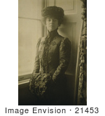 #21453 Stock Photography Of Alice Roosevelt Longworth Standing By A Window Resting Her Hands In A Muff