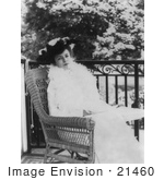 #21460 Stock Photography Of Alice Roosevelt Longworth Sitting In A Wicker Chair Outside