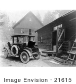 #21615 Historical Stock Photo Of A Detroit Electric Automobile Parked By A Building An Electric Cable Charging The Battery