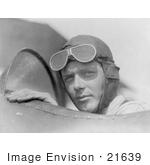 #21639 Stock Photography of Charles Lindbergh in a Helmet and Goggles, Sitting in a Plane Cockpit by JVPD
