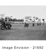 #21692 Stock Photography Of Women Performing Stunts On Motorcycles
