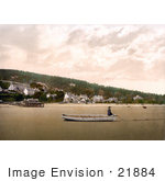 #21884 Historical Stock Photography Of A Man Sitting In A Boat On The Sand At Low Tide In Grange-Over-Sands Cumbria England