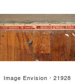 #21928 Stock Photography of Nails in a Carpet Tack Strip on a Wood Floor Following the Removal of Carpet and Padding by Jamie Voetsch