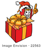 #22563 Clip Art Graphic Of A Book Cartoon Character Standing By A Christmas Present