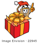 #22945 Clip Art Graphic Of A Cardboard Shipping Box Cartoon Character Standing By A Christmas Present