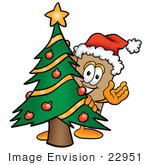 #22951 Clip Art Graphic Of A Cardboard Shipping Box Cartoon Character Waving And Standing By A Decorated Christmas Tree